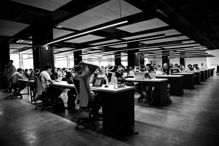 black and white photo of open concept office